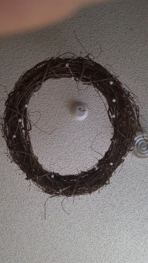 Wreath and LED lights hung with fishing line and hooks