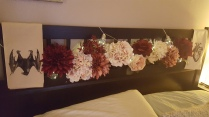 Flowers from the craft store with LED lights in the headboard